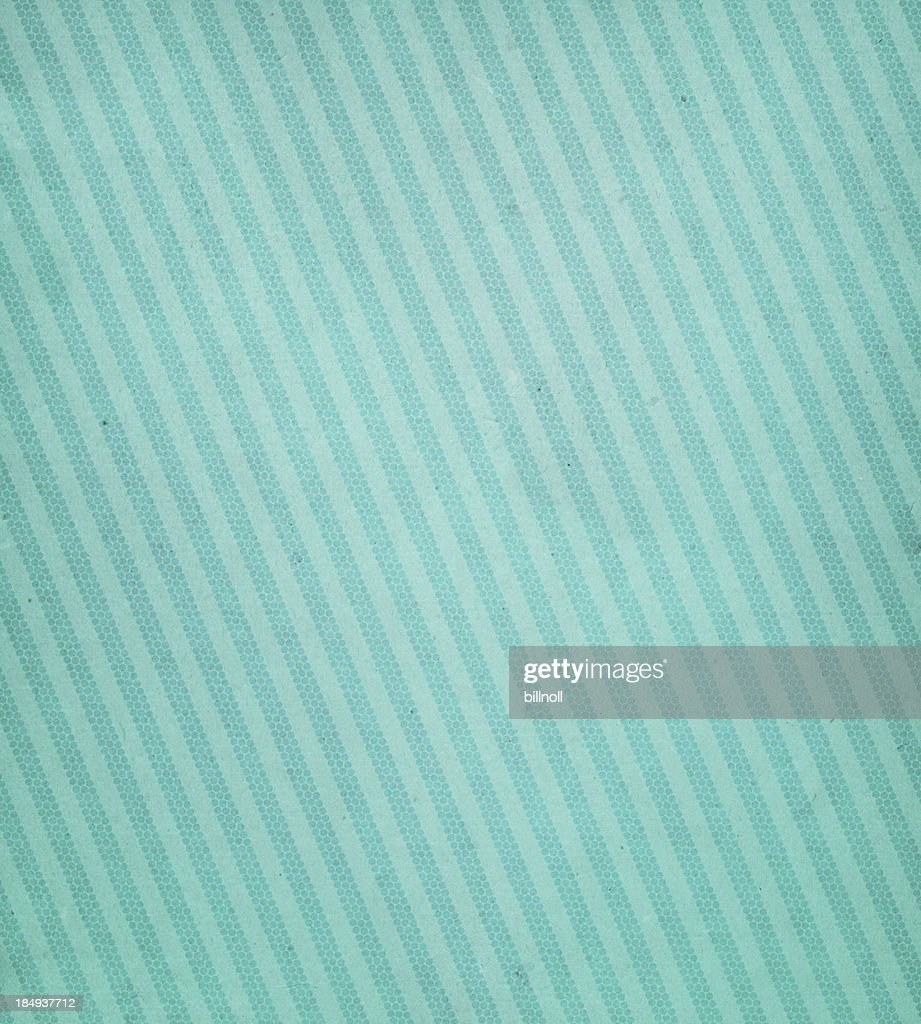 Livre vert avec des lignes obliques : Photo