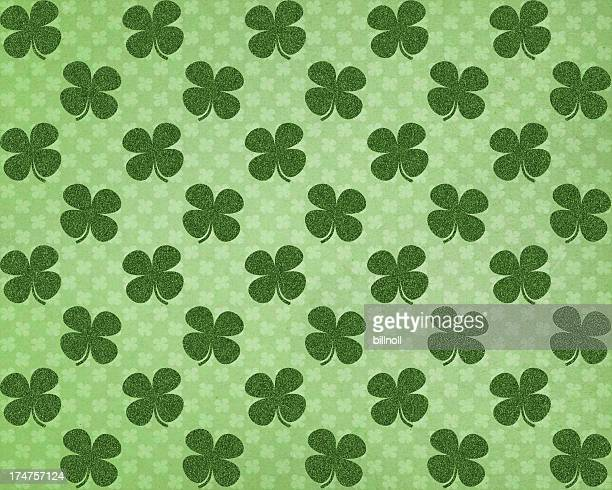 green paper with glitter clover pattern