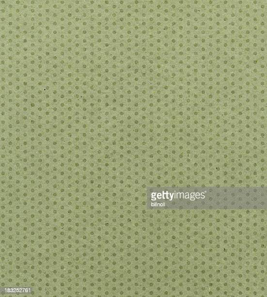 green paper with polka dots