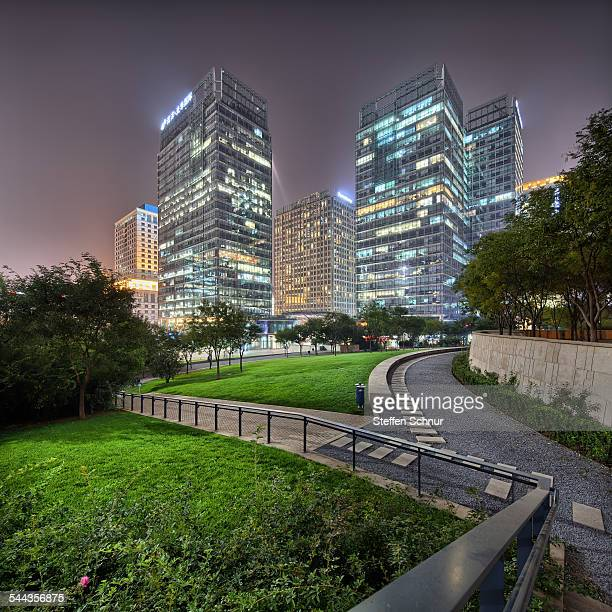 Green park with skyscrapers nature and city China