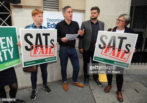 Green Party coleader Jonathan Bartley is presented with his SATs results by a teacher outside the Department for Education in Westminster London to...