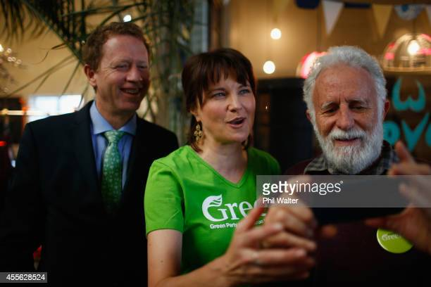 Green Party coleader Russel Norman and supporter Lucy Lawless take a photo with a guest during the Green Party election campaign event at St Kevins...