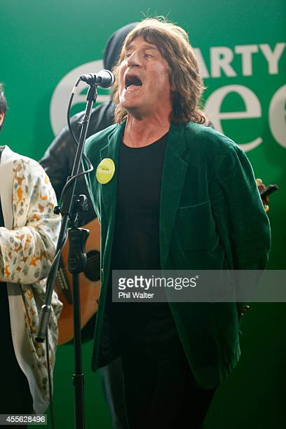 Green Party supporter Jordan Luck sings during the Green Party election campaign event at St Kevins Arcade in Auckland on September 18 2014 in...