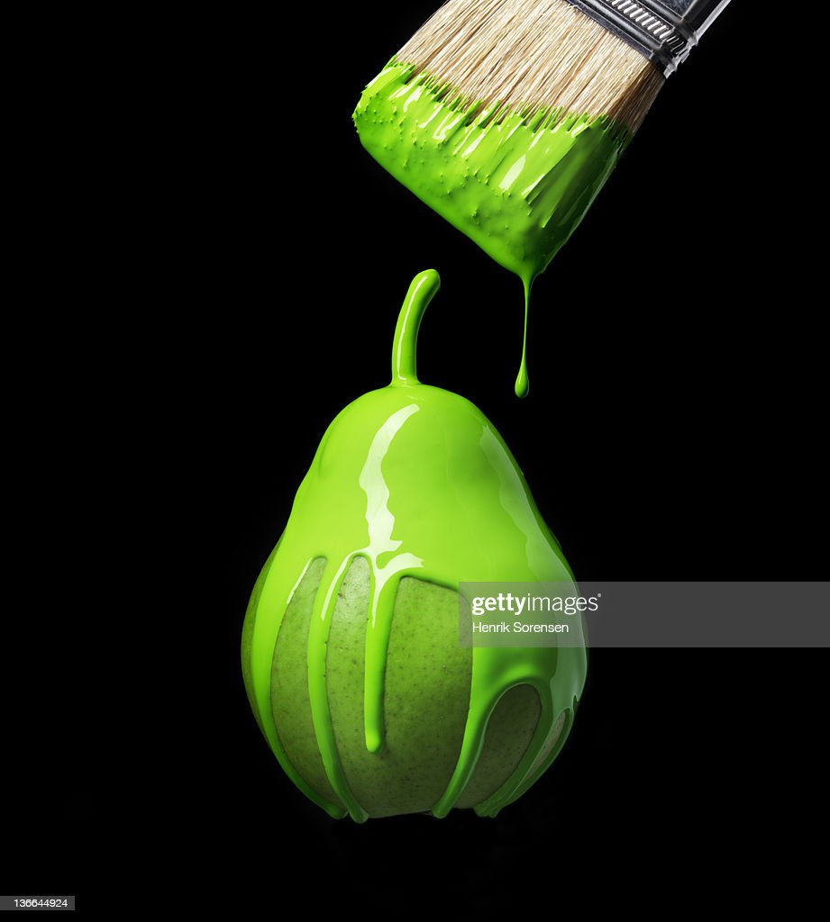green pear with green paint : Stock Photo