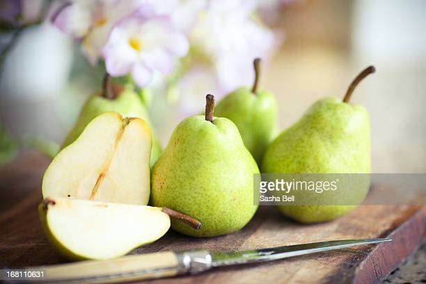 Green Pears on Wooden Board