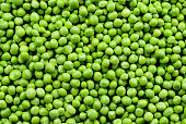 Green Peas. Green background. Peas background. Top view.