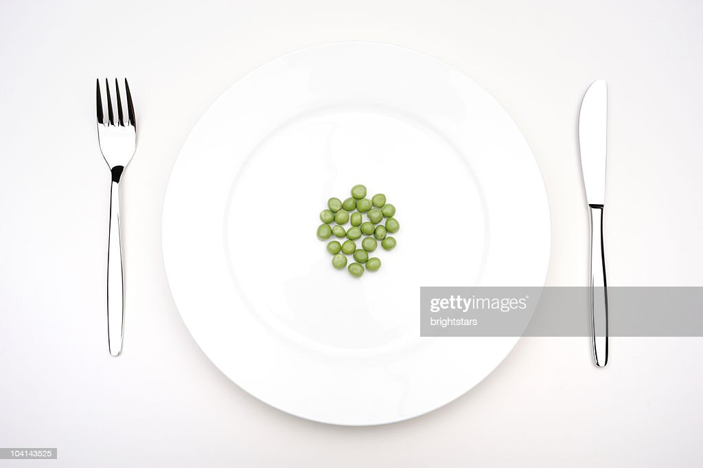 Green peas on a plate : Stock Photo