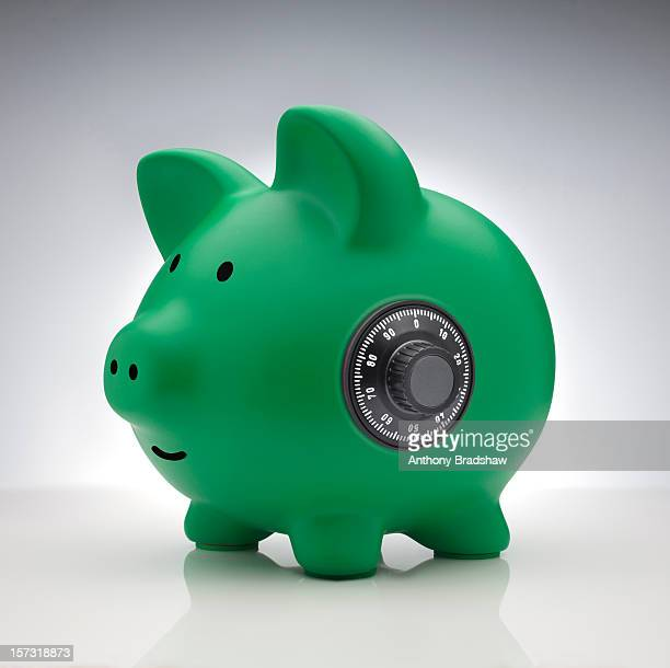 Green piggy bank with a safe combination lock