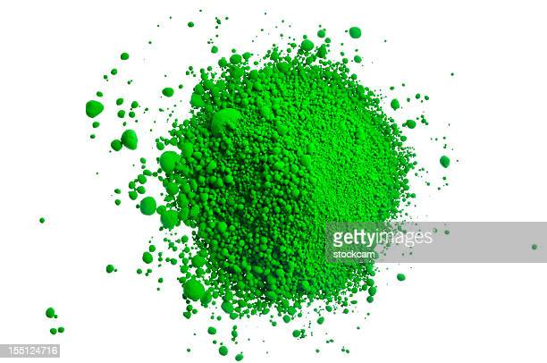 Green pile of pigment powder on white