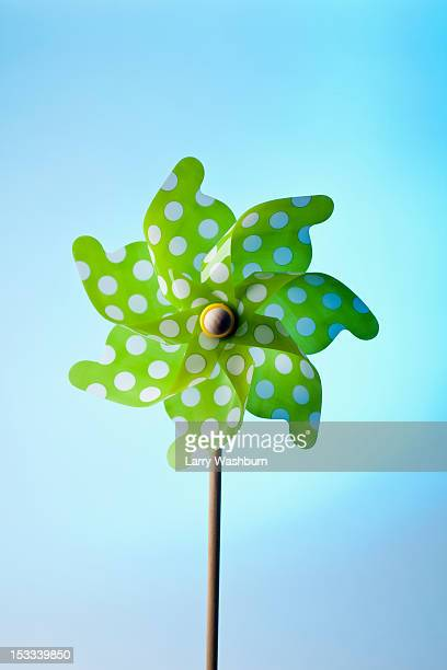 A green pinwheel with polka dots