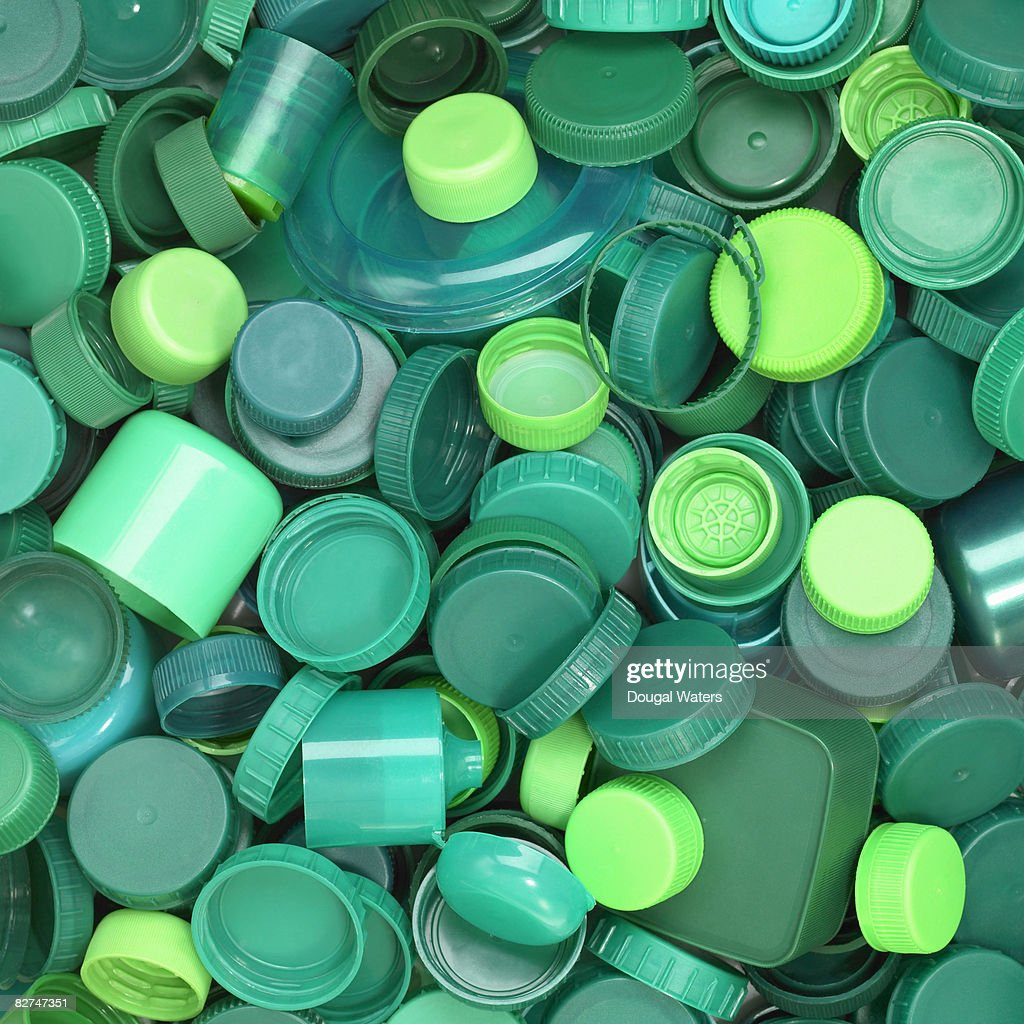 Green plastic lids close up. : Stock Photo
