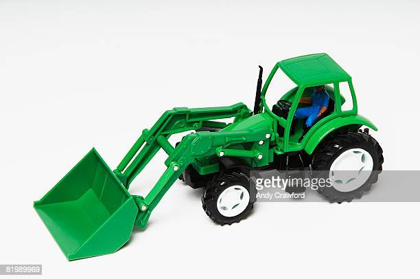 Green plastic toy tractor