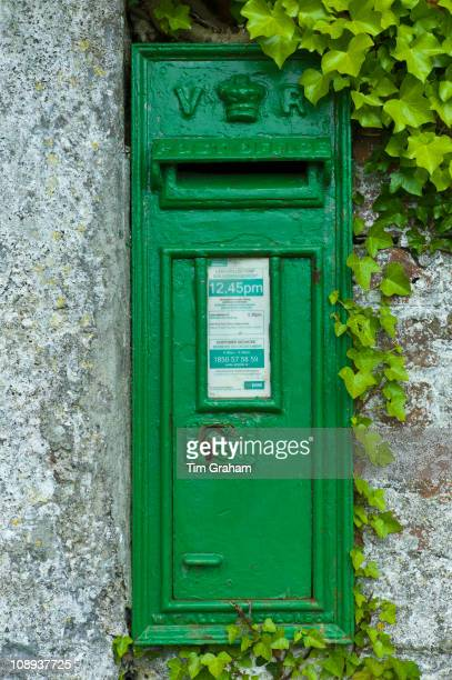Green postbox with initials VR Victoria Regina from reign of Queen Victoria at FethardonSea Co Wexford Ireland
