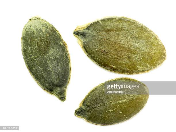 Green pumpkin seeds isolated on a white background