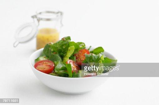 Green salad in a white bowl, studio shot