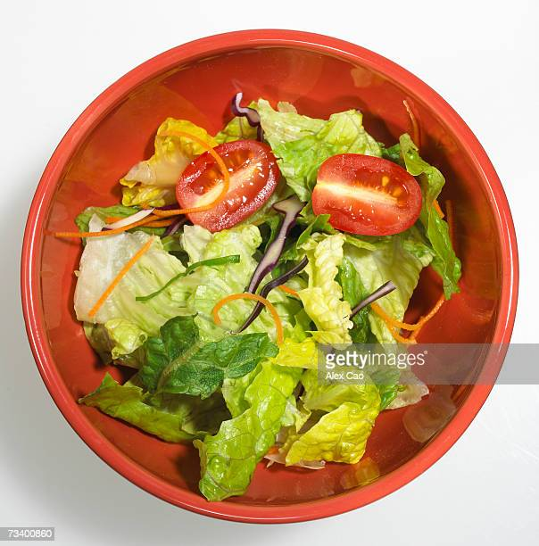 Green salad in red bowl