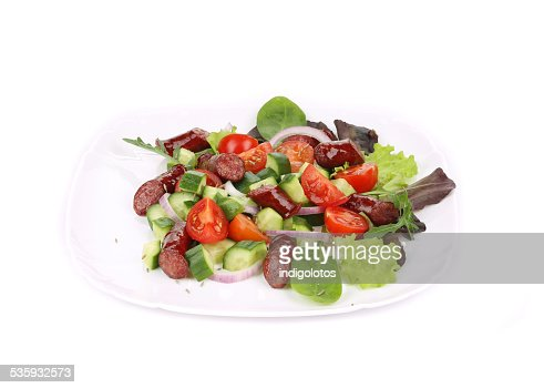 Green salad with grilled sausage. : Stock Photo