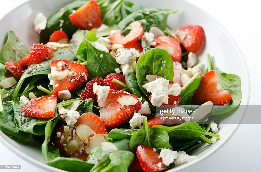 Green salad with strawberries and spinach : Stock Photo