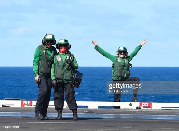 Green shirt crew members share a laugh during flight operations on July 14 2017 in Townsville Australia USS Ronald Reagan is a 1092 foot aircraft...