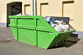Green skip (dumpster) for municipal waste or industrial waste on street