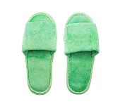 Green slippers isolated on white background