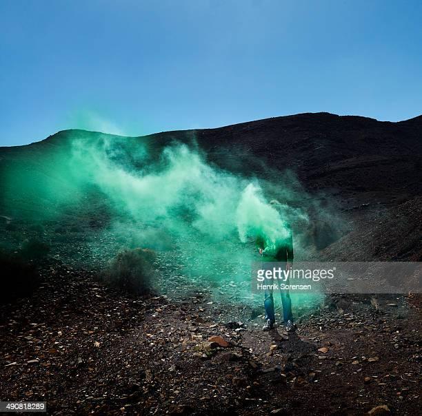 Green smoke in desert