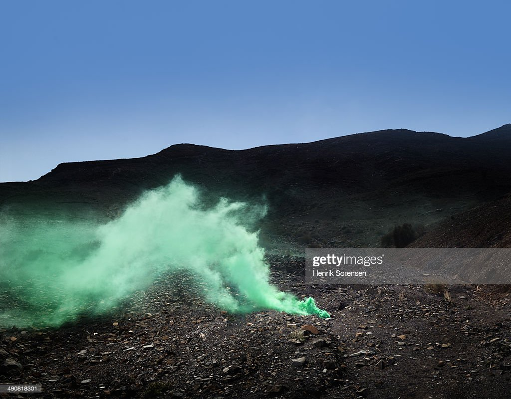 Blue skies and green smoke in the desert.