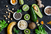 Green smoothie ingredients. Cooking healthy detox smoothies. On a dark background, top view