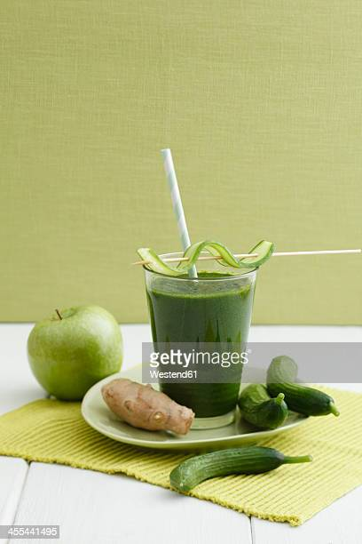 Green smoothie made of green apples, ginger and cucumber, close up