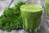 Green smoothies with kale, banana and lemon. on a wooden table. selective focus. healthy diet food