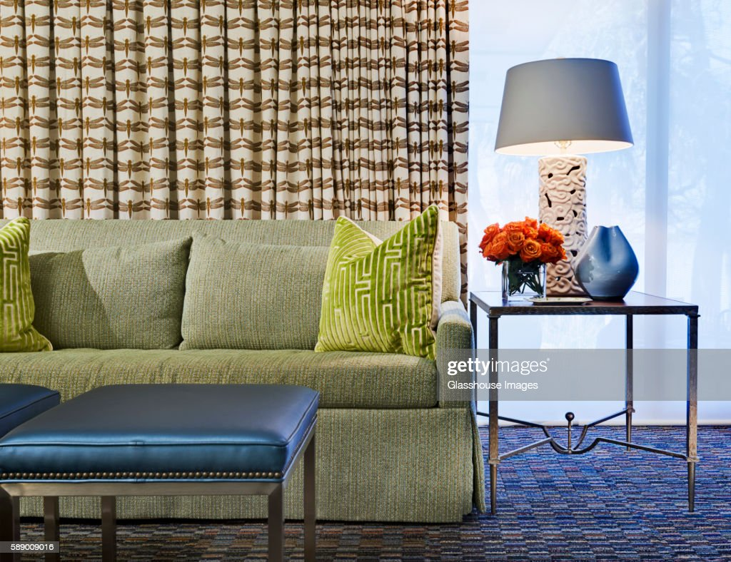 Green Sofa and Pillows next to Glass End Table, Detail