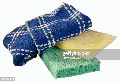 Green sponge, yellow scrubber and blue dish towel : Stock Photo