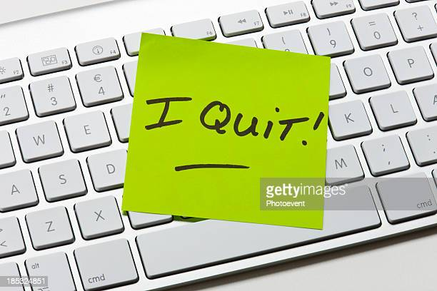 A green sticky note of resignation