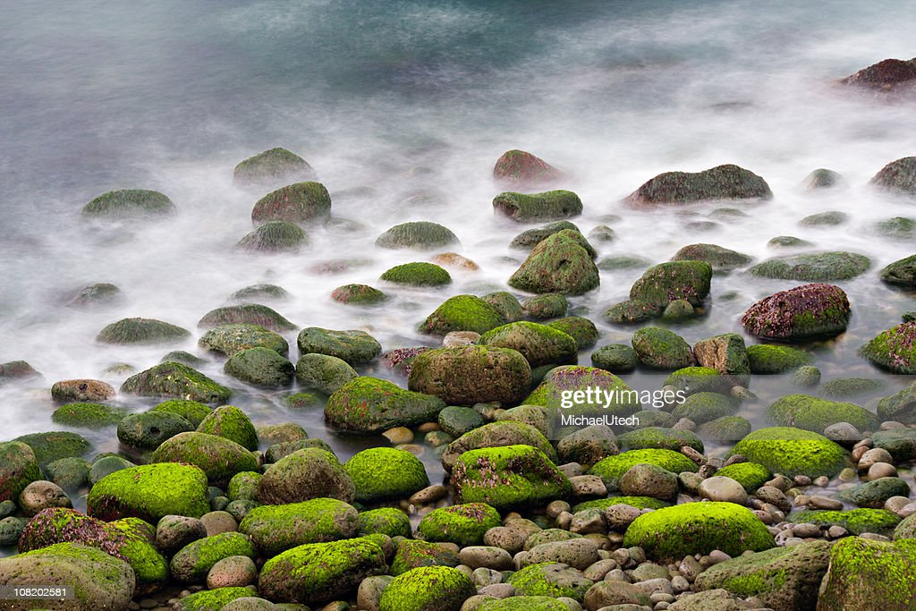 Green Stones In The Surf : Stock Photo