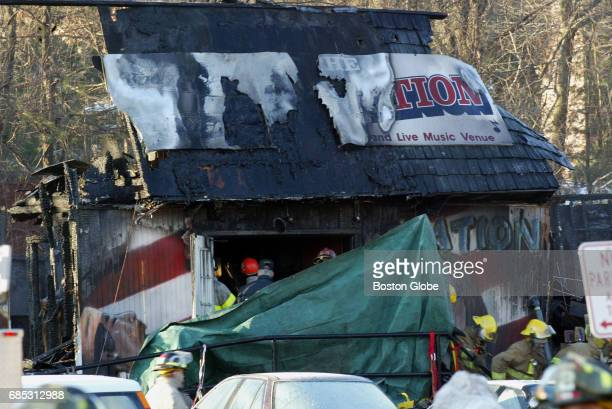 A green tarp covers the door where 100 people were killed and more than 200 injured from a crowd that attended the performance of the band 'Great...