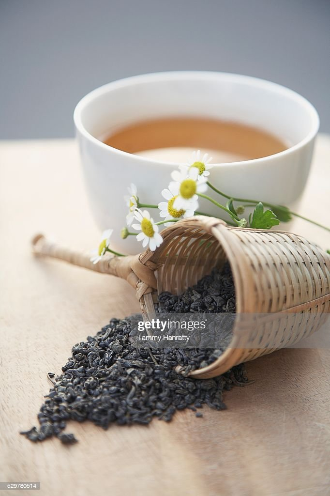 Green tea leaves and chamomile flowers : Stock Photo