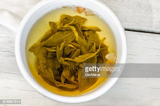 Green tea on white cup. Close up : Stock Photo