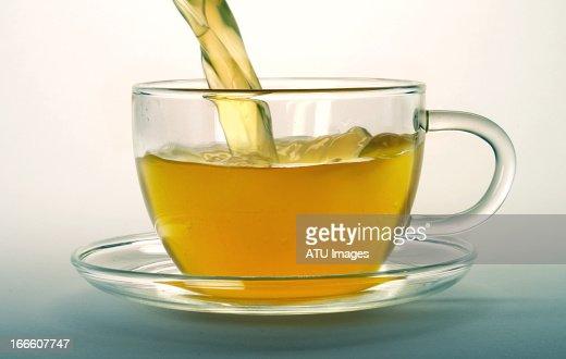 Green tea pouring