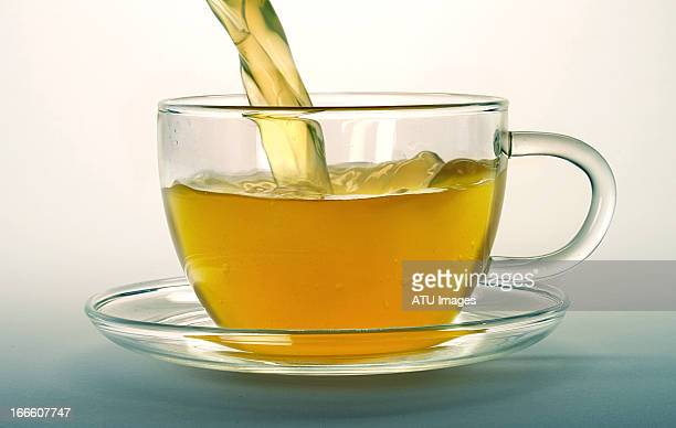 Green tea pouring