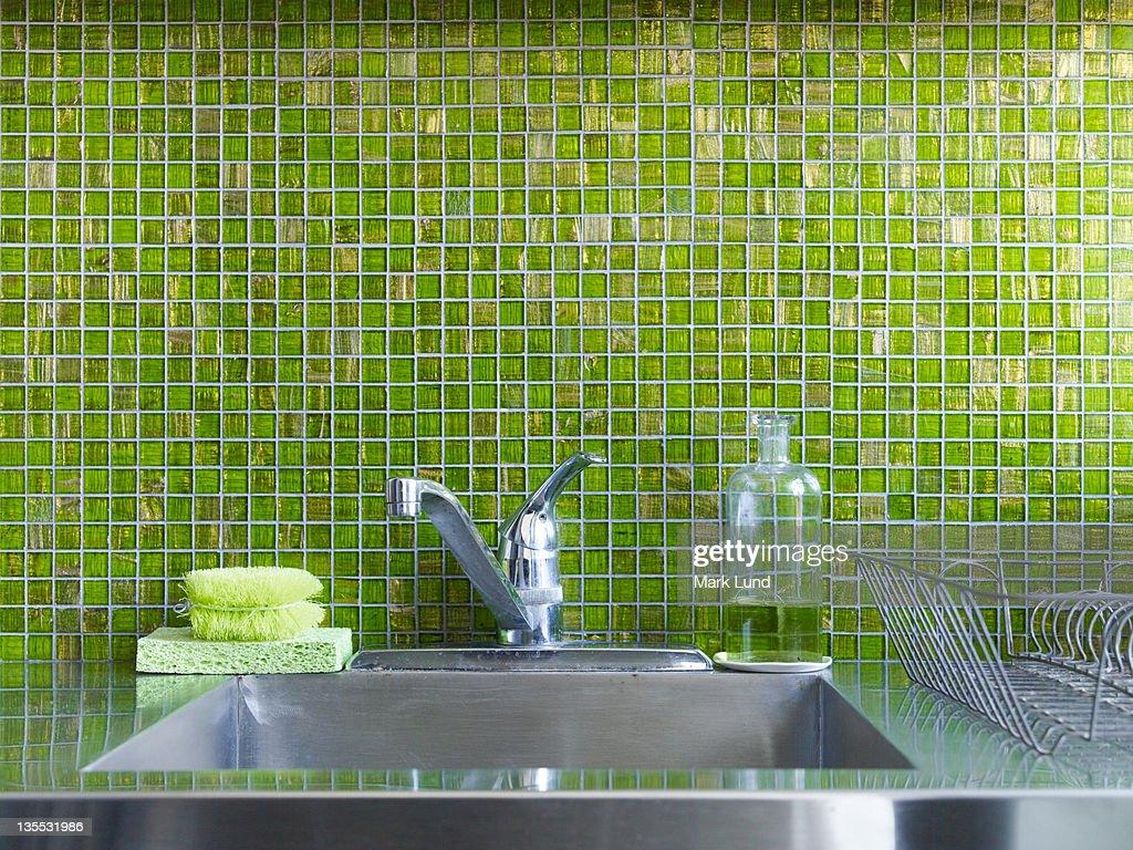 Green tiled kitchen sink