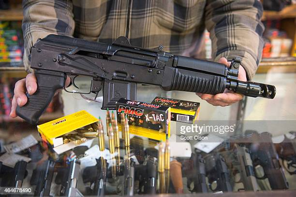 Green tipped armorpiercing 556 millimeter ammunition and an AK47 pistol that shoots the round are offered for sale at Freddie Bear Sports on February...