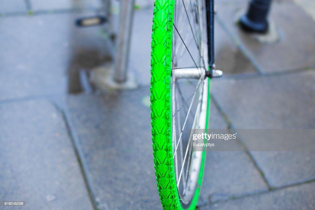 Green tire of the bike : Stock Photo