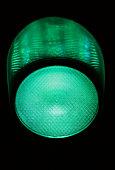 Green traffic light at night, close-up