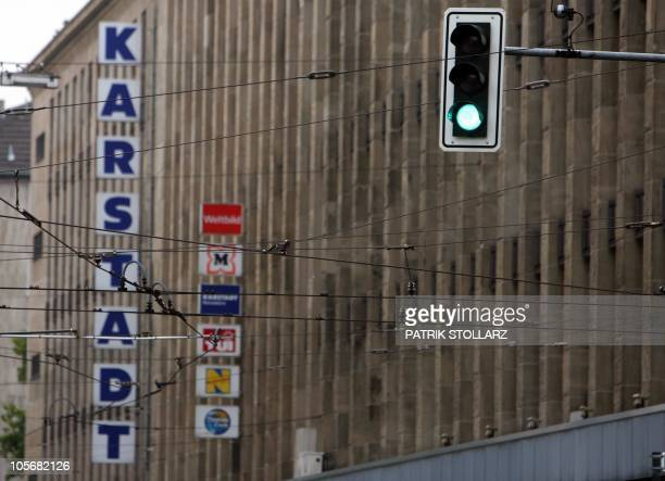A green traffic sign can be seen in front of a store of troubled German retailer Karstadt in the western German city of Duesseldorf on September 3...