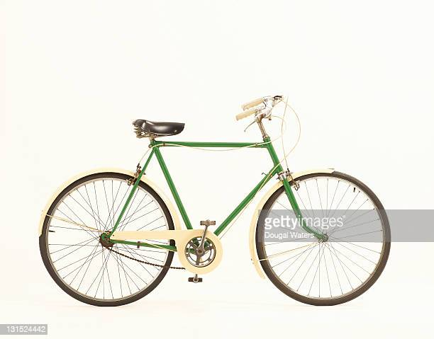 Green vintage bike against white background.