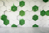 Concrete geometric wall with grass. 3D Render