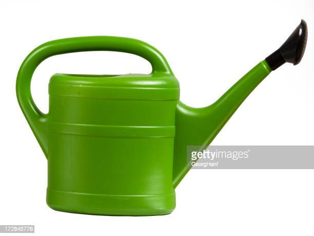 A green watering can on a white background