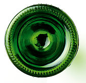 This is a graphic shot of the base of a green wine bottle