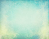 Fog and clouds on a vintage paper background.  Image displays a pleasing paper grain and texture at 100 percent.