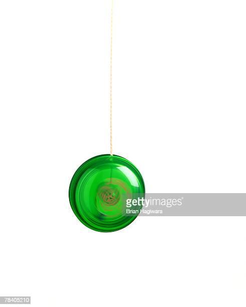 Green yo-yo on white